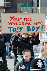 young boy at Demonstration starting at Devonshire Green Sheffield before moving through Sheffield City Centre to Barkers Pool outside Sheffield city Hall where the Liberal Democrats are holding their Party conference Conference Sheffield Saturday.12 March 2011.Images © Paul David Drabble