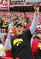 November 25, 2011: An Iowa Hawkeyes fan cheers during the first half of the NCAA football game between the Iowa Hawkeyes and the Nebraska Cornhuskers at Memorial Stadium in Lincoln, Nebraska on Friday, November 25, 2011. Nebraska defeated Iowa 20-7.