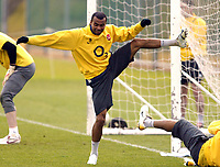Photo: Chris Ratcliffe.<br />Arsenal Training Session. UEFA Champions League. 18/04/2006.<br />Ashley Cole is tripped up by Thierry Henry during training