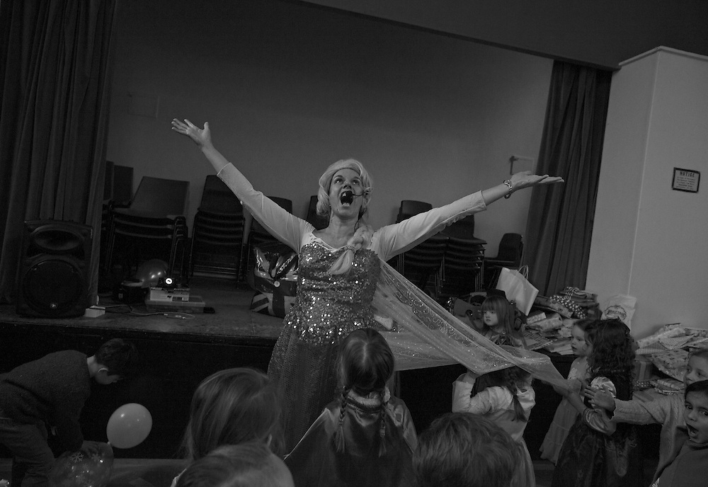 """Jackie dressed as Elsa belts out """"Let it go"""" from the the Disney Movie """"Frozen"""" as she entertains children at a party in Albury, England Saturday, Jan. 31, 2015 (Elizabeth Dalziel) #thesecretlifeofmothers #bringinguptheboys #dailylife"""