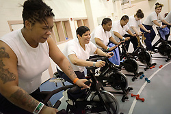 Women incarcerated at the Riverside Correctional Facility, take part in a spinning class of the Gearing-Up program