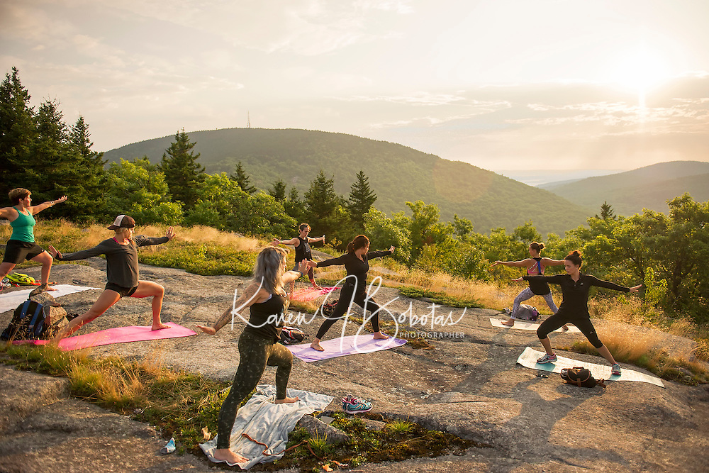 Ann Czerwinski, Joy Southworth, Sherri Benson, Kate Criscone, Kresta Turner, Lindsay Bowen and Casey McNutt  during Sunrise Yoga with instructor Kate Criscone from Body Design by Joy on top of Piper Mountain on Saturday morning.  (Karen Bobotas/for the Laconia Daily Sun)