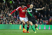 Marouane Fellaini of Manchester United battles with Stoke City forward Marko Arnautovic  during the Barclays Premier League match between Manchester United and Stoke City at Old Trafford, Manchester, England on 2 February 2016. Photo by Phil Duncan.