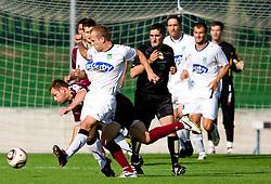 Jalen Pokorn of Triglav vs Enes Rujovic of Olimpija  during the football match between NK Triglav Gorenjska and NK Olimpija, played in the 9th Round of Prva liga football league 2010 - 2011, on September 19, 2010, Mestni stadion, Kranj, Slovenia. Olimpija defeated Triglav 5 - 0. (Photo by Vid Ponikvar / Sportida)