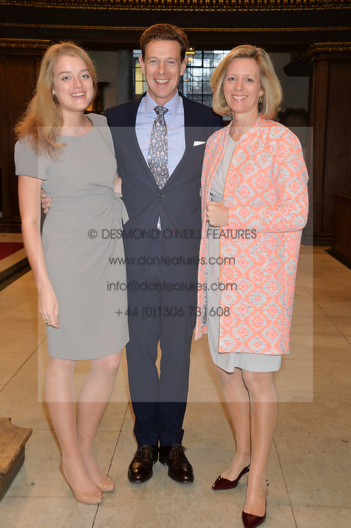 Left to right, FLORA OGILVY and her parents JAMES & JULIA OGILVY at a reception and debate to celebrate the publication of  'Women in Waiting, Prejudice at the the Heart of the Church' by Julia Ogilvy held at St.James's Church, 197 Piccadilly, London on 11th March 2014.
