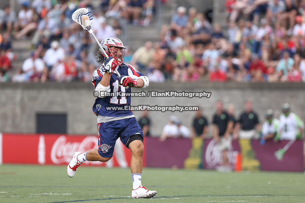 Matt Smalley #11 of the Boston Cannons runs with the ball during the game at Harvard Stadium on July 19, 2014 in Boston, Massachusetts. (Photo by Elan Kawesch)