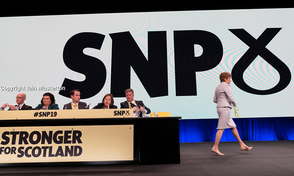 Edinburgh, Scotland, UK. 27 April, 2019. SNP ( Scottish National Party) Spring Conference takes place at the EICC ( Edinburgh International Conference Centre) in Edinburgh. Pictured; First Minister Nicola Sturgeon walks across stage in front of SNP logo