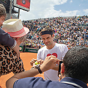 PARIS, FRANCE May 25. Roger Federer of Switzerland signing autographs after training on Court Suzanne Lenglen in preparation for the 2019 French Open Tennis Tournament at Roland Garros on May 25th 2019 in Paris, France. (Photo by Tim Clayton/Corbis via Getty Images)