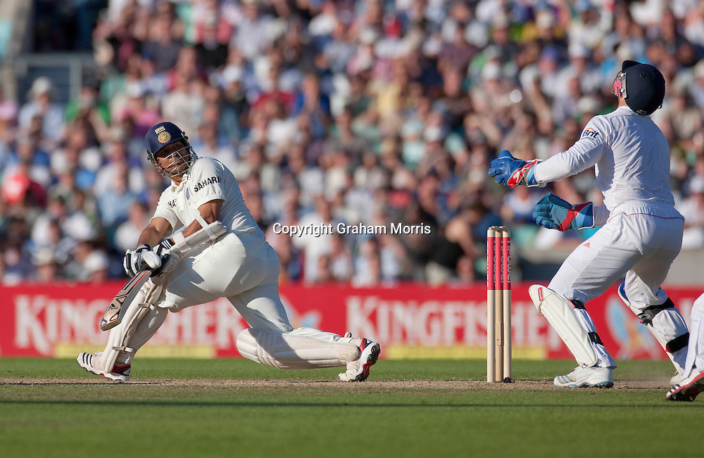Sachin Tendulkar watches as he's caught by James Anderson off Graeme Swann during the fourth and final npower Test Match between England and India at the Oval, London.  Photo: Graham Morris