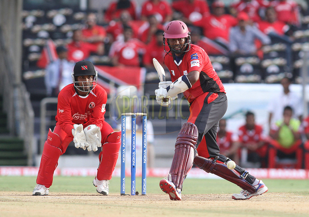 Dinesh Chandimal of the Ruhunu Eleven comes down the wicket during the Q1 match between Trinidad & Tobago and Ruhunu Eleven held at the Rajiv Gandhi International Stadium, Hyderabad on the 19th September 2011..Photo by Shaun Roy/BCCI/SPORTZPICS