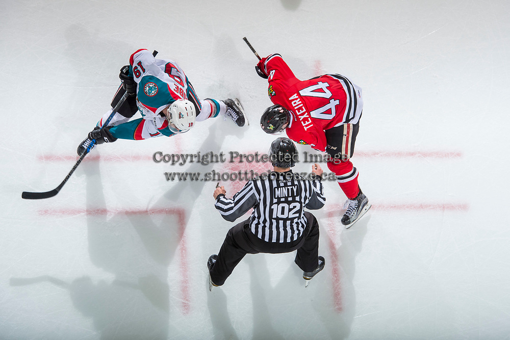 KELOWNA, CANADA - APRIL 8: Linesman Dustin Minty stands at the face off between Dillon Dube #19 of the Kelowna Rockets and Keoni Texeira #44 of the Portland Winterhawks on April 8, 2017 at Prospera Place in Kelowna, British Columbia, Canada.  (Photo by Marissa Baecker/Shoot the Breeze)  *** Local Caption ***