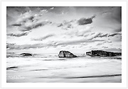 A calming seascape at South West Rocks. These rocks, just off the 'front beach', give this laid-back town its name [South West Rocks, NSW, Australia]<br /> <br /> To purchase please email orders@girtbyseaphotography.com quoting the image number 301957BW, and your preferred print size. You will receive a quick reply recommending print media options to best suit your chosen image, plus an obligation-free quotation. Current standard size prices are published on the Pricing page.