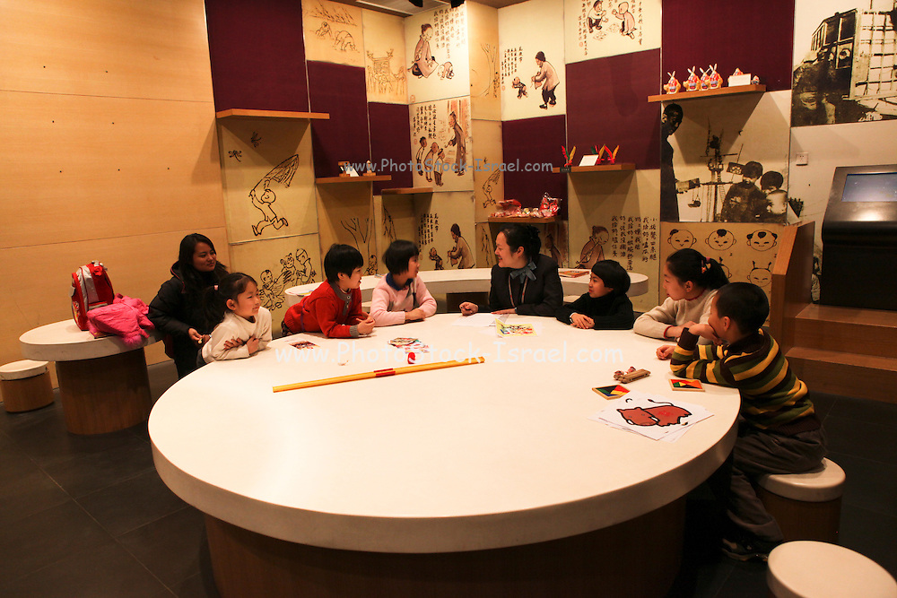 China, Tianjin, Interior of the Tianjin Museum group of children in a workshop