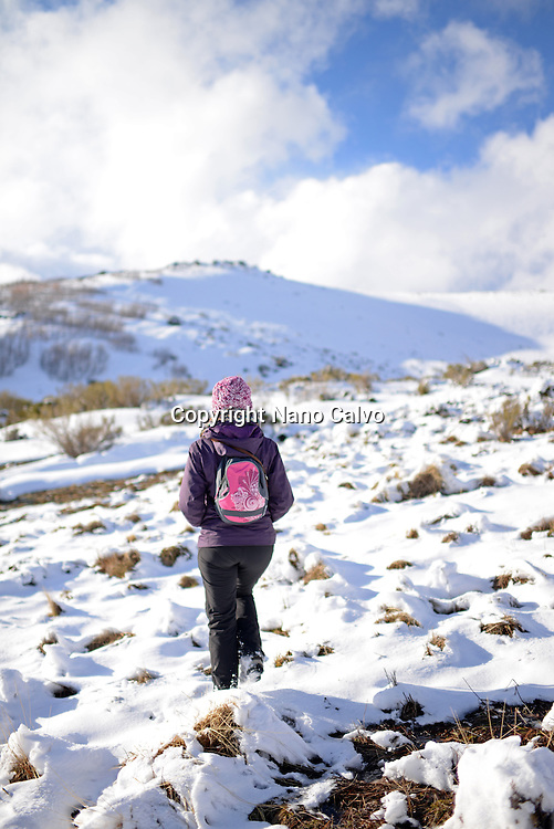 Young woman hiking in snowy mountain