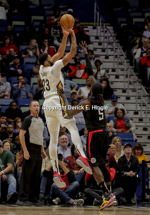 Dec 3, 2018; New Orleans, LA, USA; New Orleans Pelicans forward Anthony Davis (23) shoots over LA Clippers forward Montrezl Harrell (5) during the first quarter at the Smoothie King Center. Mandatory Credit: Derick E. Hingle-USA TODAY Sports