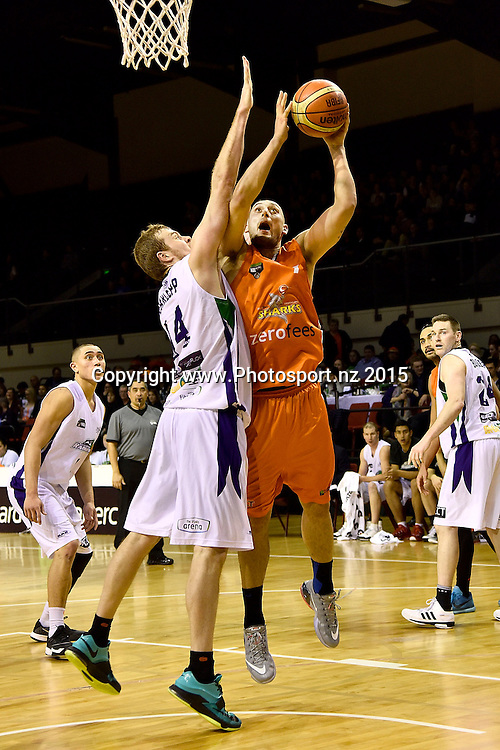 Duane Bailey (R of the Southland Sharks jumps to shoot with Tom Garlepp of the Super City Rangers during the NBL semi final basketball match between Southland and Super City Rangers at the TSB Arena in Wellington on Saturday the 4th of July 2015. Copyright photo by Marty Melville / www.Photosport.nz