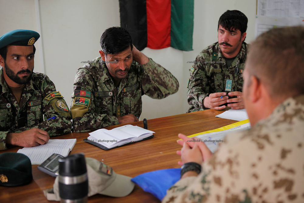 A platoon of german OMLT forces during Advisory Meetings and Talks with their equivalent ranks of Afghan National Army members in Camp Pamir near Kunduz.