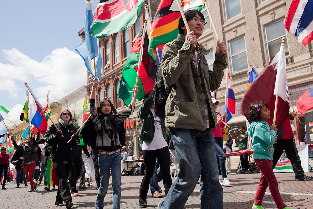 Students take part in the International Street Fair parade on Court Street in Athens, Ohio on Saturday, April 20, 2013. Photo by Chris Franz