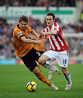 Britannia Stadium Stoke City v Wolverhampton Wanderers  (2-2) 31/10/09<br /> Dean Whitehead  (Stoke) fouls Kevin Doyle (Wolves)<br /> Photo Roger Parker Fotosports International
