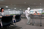 Honda Motor Co.'s humanoid robot ASIMO stands by the reception of an office during a media demonstration of Honda's new intelligence technologies, which enables the robot to act autonomously and perform uninterrupted services to office guests...Photographer: Robert Gilhooly