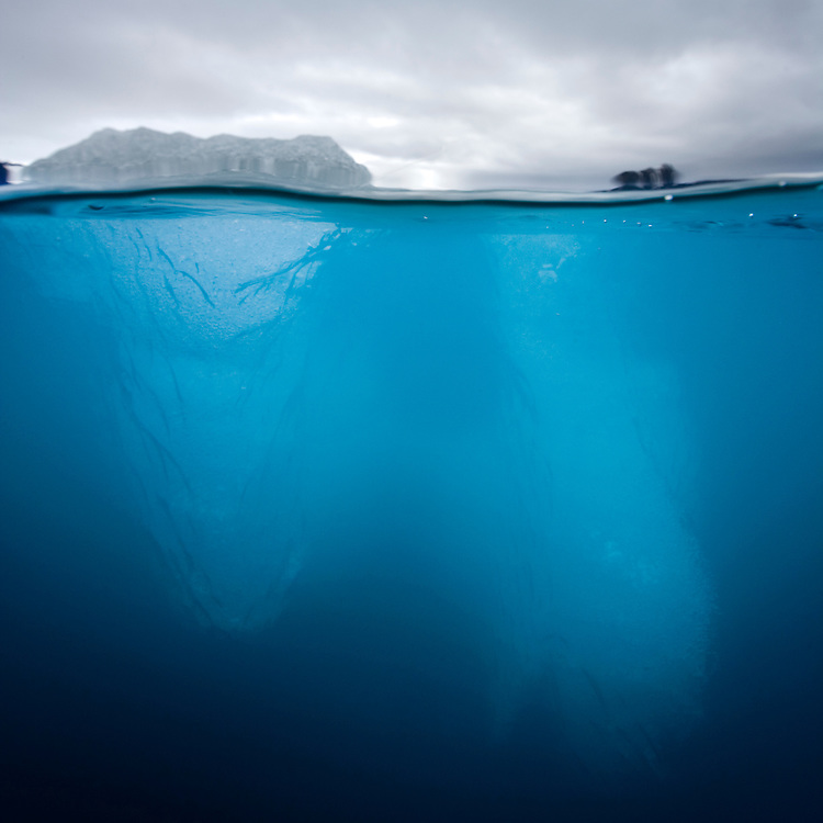 Norway, Svalbard, Spitsbergen, Underwater view of iceberg floating near face of Lilliehøøk Glacier in Lilliehøøkfjorden in Krossfjorden on summer morning