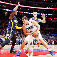 02 December 2015: Indiana Pacers forward C.J. Miles (0) and Indiana Pacers forward Chase Budinger (10) defend on Los Angeles Clippers forward Blake Griffin (32) during the Indiana Pacers 103-91 victory over the Los Angeles Clippers, at the Staples Center, Los Angeles, California, USA.