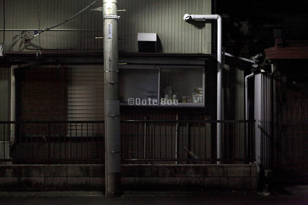 close up of an old residential house illuminated by street light Japan