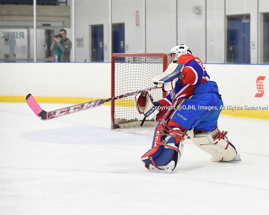 TORONTO, ON - Oct 11, 2015 : Ontario Junior Hockey League game action between Oakville and Toronto, Daniel Lopapa #30 of the Toronto Jr. Canadiens clears the puck during the second period.<br /> (Photo by Andy Corneau / OJHL Images)