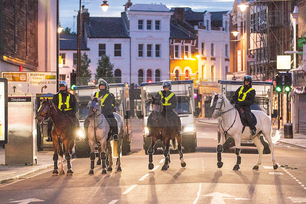 © Licensed to London News Pictures . 07/08/2011 . London , UK . Mounted police in Enfield at the start of a 2nd night of rioting and looting in London , which followed a protest against the police shooting of Mark Duggan . Photo credit : Joel Goodman/LNP