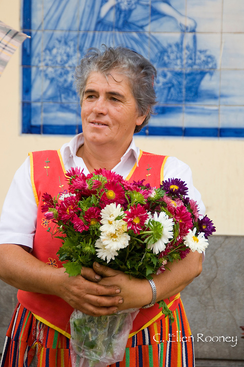 A woman in  traditional dress selling flowers outside the main market in<br /> Funchal, Madeira