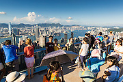 11 AUGUST 2013 - HONG KONG: People at the top of Victoria Peak in Hong Kong. Hong Kong is one of the two Special Administrative Regions of the People's Republic of China, Macau is the other. It is situated on China's south coast and, enclosed by the Pearl River Delta and South China Sea, it is known for its skyline and deep natural harbour. Hong Kong is one of the most densely populated areas in the world, the  population is 93.6% ethnic Chinese and 6.4% from other groups. The Han Chinese majority originate mainly from the cities of Guangzhou and Taishan in the neighbouring Guangdong province.      PHOTO BY JACK KURTZ
