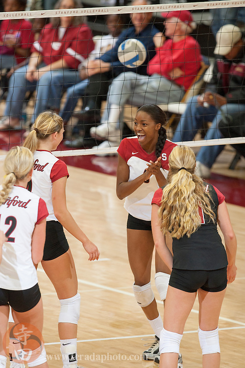 November 25, 2006; Stanford, CA, USA; Stanford Cardinal outside htiter Erin Waller (12), setter Bryn Kehoe (4), middle blocker Franci Girard (6), and libero Jessica Fishburn (11) celebrate during the game against the Washington State Cougars at Maples Pavilion. The Cardinal defeated the Cougars 30-27, 30-23, 30-18.