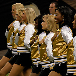 2009 August 14: Saintsations dancers lineup during the national anthem before the start of a preseason opener between the Cincinnati Bengals and the New Orleans Saints at the Louisiana Superdome in New Orleans, Louisiana.