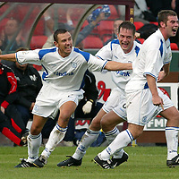 Falkirk v St Johnstone...27.09.03.<br />Peter MacDonald celebrates his second goal with John Robertson and Ian Maxwell<br /><br />Picture by Graeme Hart<br />Perthshire Picture Agency<br />Tel: 01738 623350 / 07990 594431