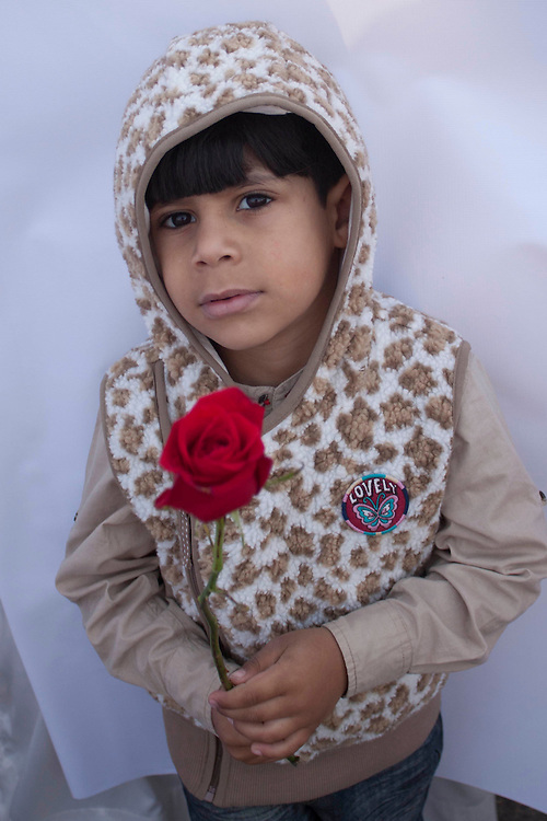 A young boy holds a rose, the symbol of a peaceful protest, at Pearl Roundabout in Manama, Bahrain.