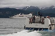 Chile. Puerto Williams   fishermen port , in the distance,  cruise boat , the Diamond , Of the compagnie Ponant islands   / Puerto williams la ville la plus australe de la planete   , bateau le DIAMANT, compagnie des iles du PONANT  . Chili