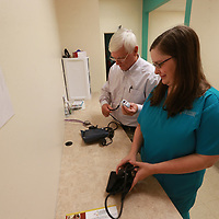 Dr. herman Palmer, left, and Jordan Hancock gather their items for an exam at Lifecore in Tupelo.