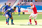 Charlton Athletic midfielder Jonathan Williams challenged by Wigan Athletic defender Nathan Byrneduring the EFL Sky Bet Championship match between Wigan Athletic and Charlton Athletic at the DW Stadium, Wigan, England on 21 September 2019.
