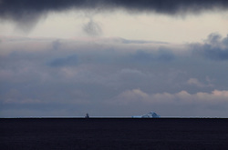 ATLANTIC OCEAN ABOARD ARCTIC SUNRISE 31MAY11 - A vessel tows an iceberg near the drill site of the Ocean rig Corcovado in the Lady Franklin field in Baffin Bay, Greenland.....jre/Photo by Jiri Rezac / Greenpeace