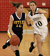 Butler's Tiffany Taynor (left) brings the ball downcourt as Fairmont's Christine Grimme defends at the Girls Division I sectional basketball finals, held at Troy High School, Saturday afternoon.