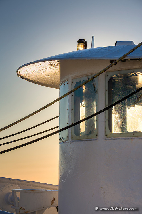 Wheel house of a fishing trawler docked at Wancheese harbor, photograph at sunrise.