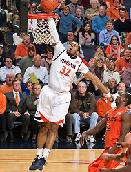 Virginia forward Mike Scott (32) goes up for a dunk against VT. The Virginia Cavaliers defeated the Virginia Tech Hokies 75-61 at the John Paul Jones Arena on the Grounds of the University of Virginia in Charlottesville, VA on February 18, 2009.