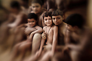 Group of Kushti wrestlers taking a break from their practice, Varanasi, India