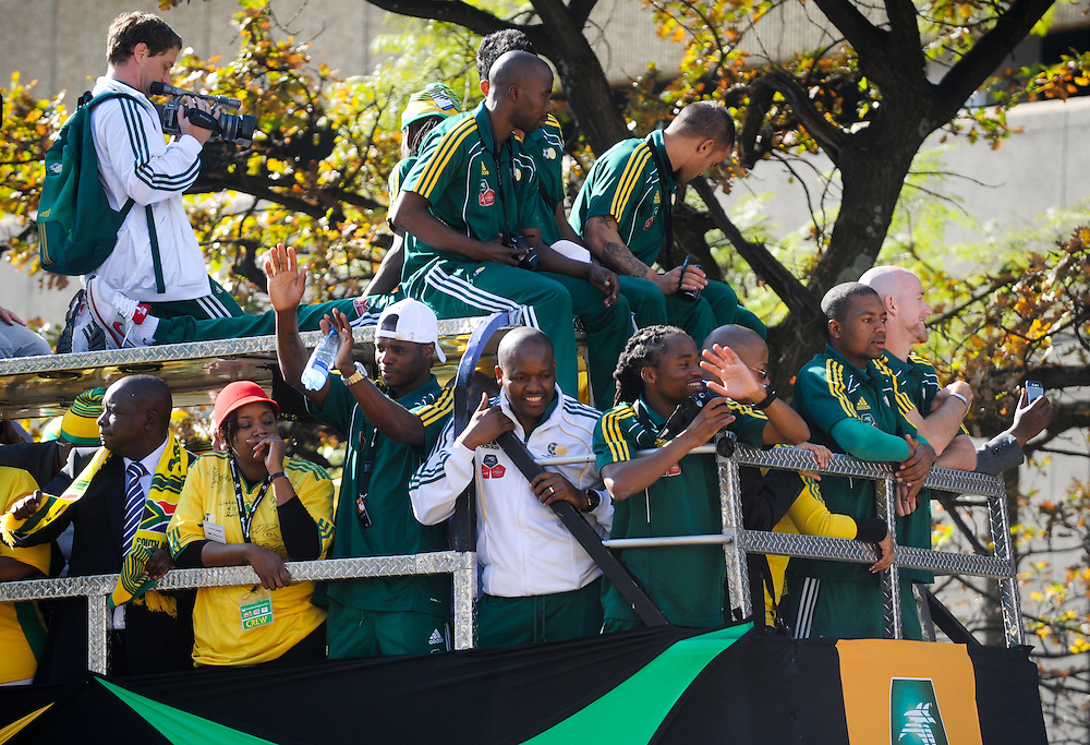"Team buses parade through the crowd at the ""United We Shall Stand"" rally for the South African national soccer team, Bafana Bafana, Tuesday, June 9, 2010 in Johannesburg, South Africa. South Africa is hosting the FIFA World Cup, which begins June 11. Photo by Bahram Mark Sobhani"