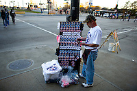 A Obama supporters sells buttons and t-shirts as spectators and supporters take to Chicago's Grant Park for the election night results for the presidential race between Sen. Barak Obama (D-IL) and Sen. John McCain (R-AZ) Tuesday Nov. 4, 2008 Chicago IL.
