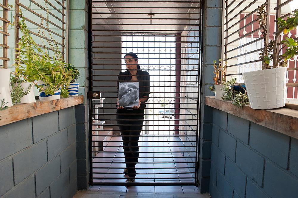 Marcela Guadiana, book designer, at her home in Tijuana.  ..© Stefan Falke.http://www.stefanfalke.com/..
