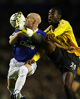Photo: Paul Thomas.<br /> Everton v Arsenal. Carling Cup. 08/11/2006.<br /> <br /> Andy Johnson (L) of Everton is tackled by Johan Djourou, which lead to a possible foul in the Arsenal box. This is what lead to Everton's James McFadden getting sent off.