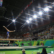 Gymnastics - Olympics: Day 2    Lieke Wevers #371 of The Netherlands performing her routine on the Balance Beam during the Artistic Gymnastics Women's Team Qualification round at the Rio Olympic Arena on August 7, 2016 in Rio de Janeiro, Brazil. (Photo by Tim Clayton/Corbis via Getty Images)<br /> <br /> (Note to editors: A special effects starburst filter was used in the creation of this image)