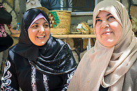 Local weavers Alia and Um Hani make their living by weaving and selling baskets in Umm Qais.
