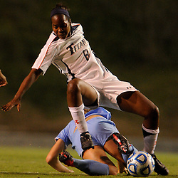 Cal State Fullerton sophomore forward Nikki McCants (8) is tripped up by a San Diego player during Fullerton's 2-0 victory on Sept. 22, 2011 at Titan Stadium.